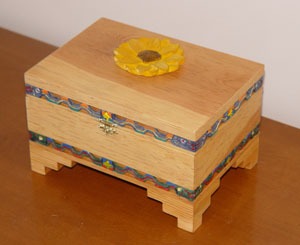 Southwest Style with fretwork and sunflower carving on lid